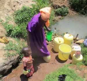 The Water Project:  Women Bring Their Children With Them To Fetch Water