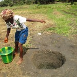 The Water Project: Mayaya Village A -  Fetching Water