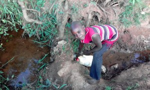 The Water Project:  Christine Fetching Water