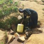 The Water Project: Futsi Fuvili Community, Futsi Fuvili Spring -  Mr Alfred Fetches Water