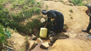 The Water Project : 5-kenya4729-mr-alfred-fetches-water