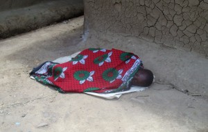 The Water Project:  A Kid Ailing From Malaria Sleeping Outside Her House With No Medical Attention