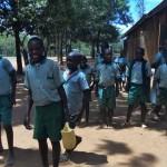 The Water Project: Emukangu Primary School -  Carrying Water