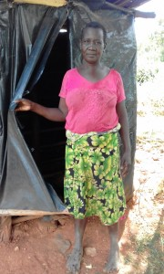 The Water Project:  Mrs Jane Proud Of Her Improvised Latrine