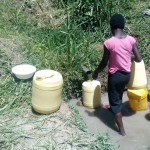 The Water Project: Handidi Community -  Lady Fetching Water