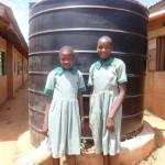 The Water Project: Emukangu Primary School -  Girls Next To The Liter Tank