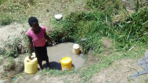 The Water Project : 7-kenya4725-lifting-a-full-container