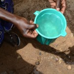 The Water Project: Ilinge Community -  Family One Fetching Water