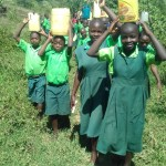 The Water Project: Emusoma Primary School -  Carrying Water Back