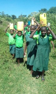 The Water Project : 8-kenya4692-carrying-water-back