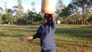 The Water Project:  School Cook Carrying Container From Spring