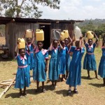 The Water Project: Maganyi Primary School -  Girls Posing With Jerrycans