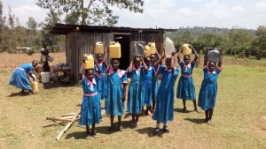 The Water Project:  Girls Posing With Jerrycans