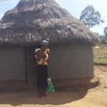 The Water Project: Futsi Fuvili Community -  Mrs Nellie In Front Of Her Home