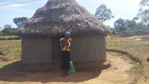The Water Project : 8-kenya4729-mrs-nellie-in-front-of-her-home