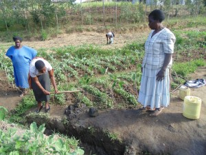 The Water Project:  Rose A Wewasafo Staff Helps Community Clear Its Drainage Trench