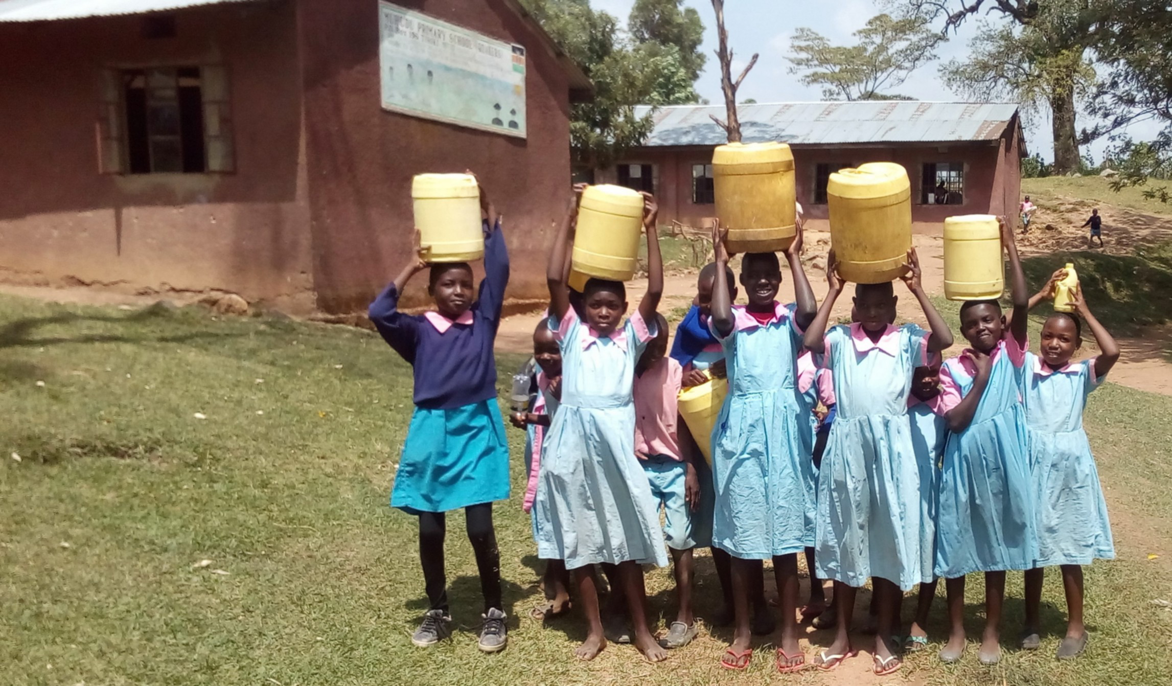 The Water Project : 9-kenya4688-students-with-their-water-containers