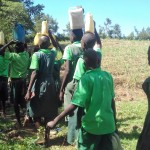 The Water Project: Emusoma Primary School -  Carrying Water