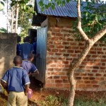 The Water Project: Iyenga Primary School -  Boys Wait For Latrines