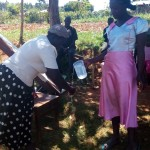 The Water Project: Bumavi Community, Shoso Mwoga Spring -  Hand Washing Demonstrations