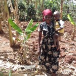 The Water Project: Igogwa Community -  Mrs Seregwa And Her Son