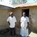 The Water Project: Shiamboko Community, Oluchinji Spring -  Mr And Mrs Oluchinji Outside Their Home