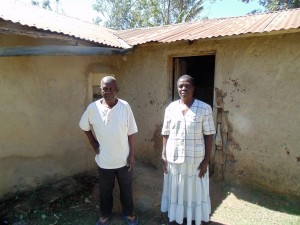 The Water Project : 9-kenya4732-mr-and-mrs-oluchinji-outside-their-home