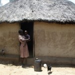 The Water Project: Mulundu Community -  Mrs Aseka And Her Son At Their Home