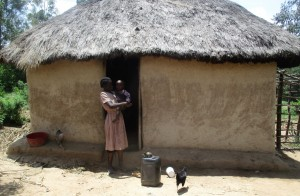 The Water Project:  Mrs Aseka And Her Son At Their Home