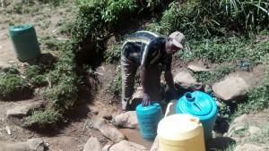 The Water Project:  Zablon Fetching Water At Matunda Spring