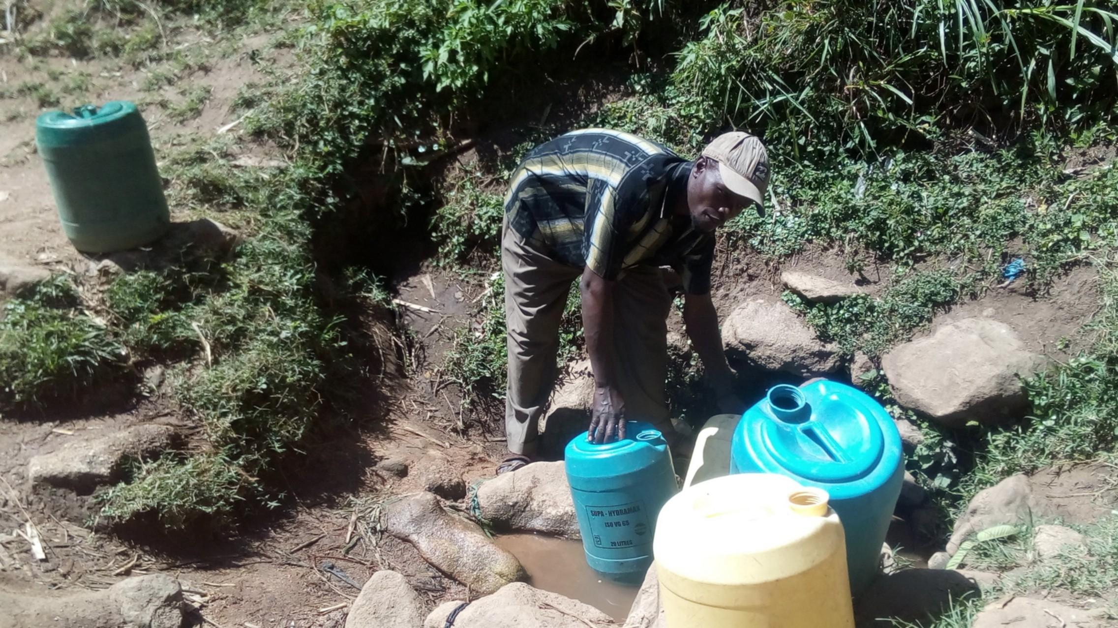 The Water Project : 1-kenya4739-zablon-fetching-water-at-matunda-spring