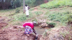 The Water Project:  Woman Washing Her Hands