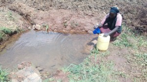 The Water Project:  Mrs Lihala Fetching Water