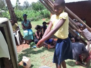 The Water Project:  Jessica Practices Hand Washing