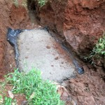 The Water Project: Mutambi Community, Kivumbi Spring -  Excavating And Setting Foundation Base