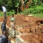The Water Project: Mutambi Community, Kivumbi Spring -  Backfilling Process