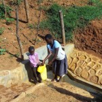 The Water Project: Shitaho Community B -  Mother And Son Fetch Water