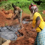 The Water Project : 18-kenya4706-community-members-help-backfill