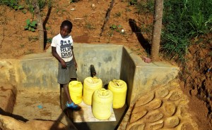 The Water Project:  Girl Waiting To Fill Containers