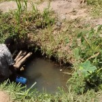 The Water Project: Lutali Community, Lukoye Spring -  Fetching Water