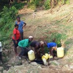 The Water Project: Mumuli Community, Shalolwa Spring -  Community Members Fetching Water