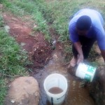 The Water Project : 2-kenya4738-fetching-water-from-shihachi-spring