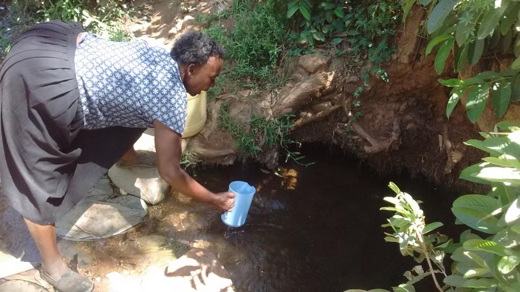 The Water Project : 2-kenya4744-mrs-lukanda-fetching-water