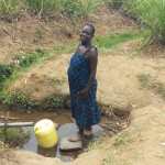 The Water Project : 2-kenya4747-mrs-alice-aliyo-fetching-water