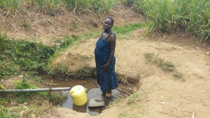 The Water Project:  Mrs Alice Aliyo Fetching Water