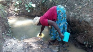 The Water Project:  Elizabeth Fetching Water At Saina Spring