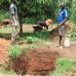 The Water Project: Shikhuyu Community -  Artisan Discussing Digging A Latrine Pit