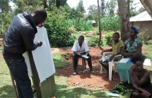 The Water Project : 3-kenya4715-explaining-how-spring-protection-works