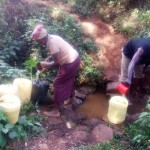 The Water Project: Lutonyi Community -  Fetching Water From Shihachi Spring