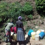 The Water Project: Handidi Community, Matunda Spring -  Scramble Around The Water Point
